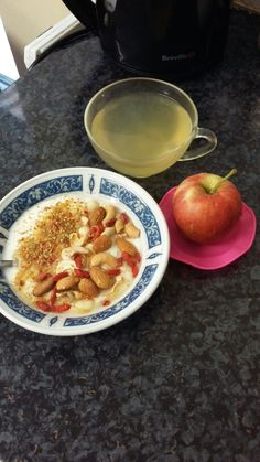apple, greek yogurt topped with 1 tsp of milled linseeds, cashew nuts ...