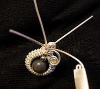 This site has some great tutorials for wire work.