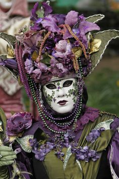 Venice Carnival costume and mask of garden greens and purple
