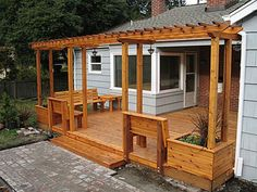 Deck with pergola, benches and built in planter boxes