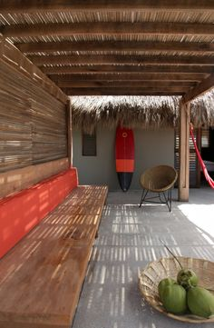Patio at Hotel Escondido in Mexico with Wood Outdoor Bench and Orange Accents, Remodelista