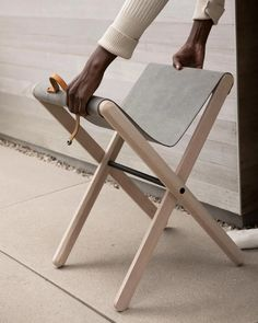 Folding Stool Small but perfectly formed, this Folding Stool combines ash wood and natural canvas in an intuitively simple structure. An instant contemporary classic. Folding Furniture, Folding Stool, Wood Furniture, Furniture Design, Wood Chair Design, Folding Seat, Outdoor Furniture, Leather Counter Stools, Leather Stool