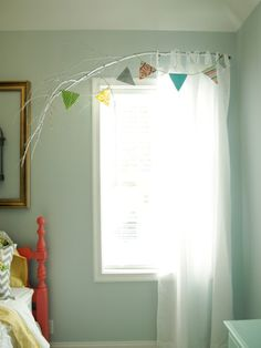 Branch above dining window with burlap banner from Robin.