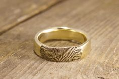 It's like your loved one just touched the end of their finger on the outside of your ring, leaving their mark. Handmade in Topsham Maine by Brent&Jess See more here: http://www.brentjess.com/product-page?prodid=1591