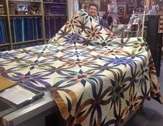 Marlene Yaw finished this gorgeous king size Bali Wedding Star quilt.  She loves our selection of over 1000 batiks!