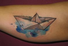 Paper boat tattoo with watercolour water