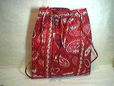 Vera Bradley Backsack in Mesa Red         This fun, lightweight bag couldn't be easier to use! Top pulls open in a flash, then closes with a quick p
