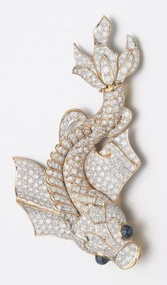 DIAMOND AND SAPPHIRE FISH BROOCH