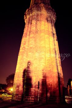 long shadow on Qutub Minar. Its a mirage of reflections