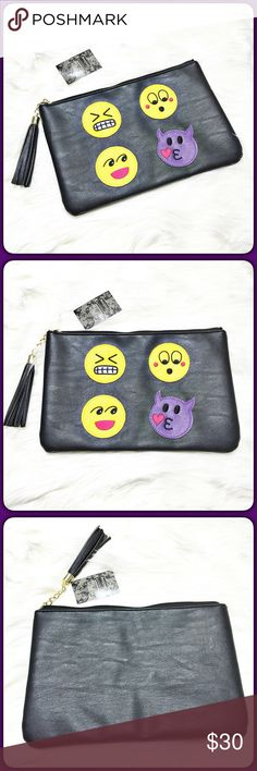 """Fun Emoji Clutch  Cute faux leather clutch adorned with some of our favorite emojis.  Has gold hardware and black tassel.  Inside has a zipper pocket and two open pockets.  Big clutch!!  Will hold everything!  Measures 12"""" x 8"""". Chateau Bags Clutches & Wristlets"""