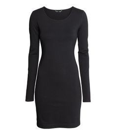 Dark blue melange. Short, fitted dress in soft jersey with long sleeves.