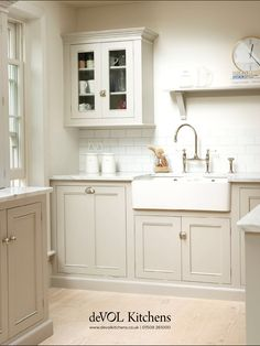 Sink area will look like this since I have apron sink. Is this how the cabinets will look? How about the trim? Will the hinges be exposed?