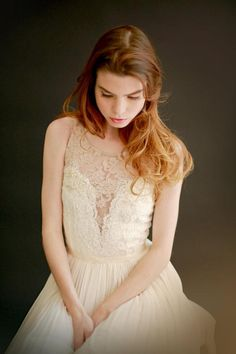 A nude lace overlay makes this gorgeous gown's deep V neckline a touch more demure. #etsyweddings