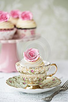 Afternoon tea with rose cupcakes by Ruth Black, via Dreamstime