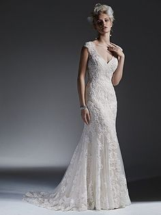 Sottero and Midgley - LYDIA, Beaded lace appliqués adorn tulle in this stunning modified A-line wedding dress with a romantic keyhole back. Finished with covered buttons over zipper closure.