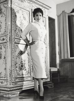Gina Lollobrigida wearing an elegant dress