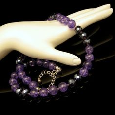 PRETTY PURPLE GLASS BEADS! The purple beads are crackle glass with dark blue accent AB crystal beads. Unique and lovely! $79.95. See this and more great vintage necklaces in my eBay store: http://stores.ebay.com/My-Classic-Jewelry-Shop/Necklaces-/_i.html?_fsub=1589284016&_sid=102404336&_trksid=p4634.c0.m322