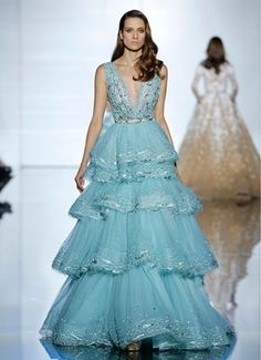 Full-length ruffle dress with plunging neckline, adorned with tonal sequins and cabochons