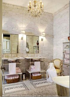 An antique chandelier, a burnished cast-iron tub, silver decor, and a vintage pharmacy cabinet give the bathroom in designer Betty Lou Phillips's home its luxurious French style. Description from pinterest.com. I searched for this on bing.com/images