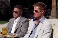 Oceans 11 (2001)- George Clooney as Danny Ocean and Brad Pitt as Rusty Ryan