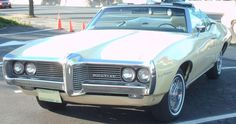 '69_Pontiac_LeMans convertible',  I had a light blue with a black top conv....miss that car