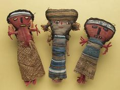 Chancay dolls - Peruvian Dolls made with textiles embroidered on their faces.