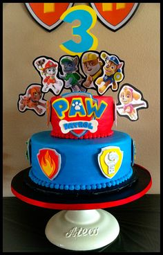 """Two Tiered Paw Patrol Birthday Cake for son's birthday.  6"""" & 8"""" cakes frosted with vanilla buttercream.  Accents (logo and shields) created with fondant."""