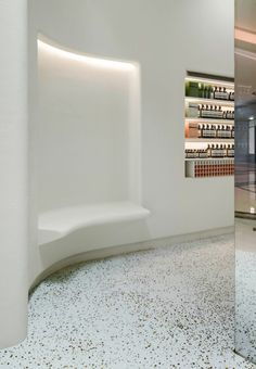 A monochromatic palette, made of terrazzo blended with glass fragments of aesop bottles and walls covered in textured paint, define the retail setting, and provide a tranquil space withing the bustling mall. Portland, Commercial Design, Commercial Interiors, Macau, Aesop Store, Retail Architecture, Terrazzo Flooring, Retail Interior, Design Studio