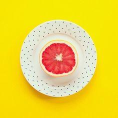 Simple yet striking mix of vibrant yellow, polka dots and grapefruit. Image via Pinterest.