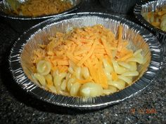 """Fun """"tinfoil dinner"""" for the kids while camping. Even older """"kids"""" (aka grandpa) loved it! (For each one) 4 3/8"""" disposable aluminum pie pan (found over with all disposable baking pans) 1/2 cup cooked elbow macaroni 1/4 cup shredded cheddar 1 tablespoon parmesan 1 tablespoon milk 1/2 T butter salt and pepper to taste Tinfoil For each dish, let the kids combine all ingredients in their pan. Then seal it in foil (a double layer if cooking over an open flame) Fold over extra foil at the top to…"""