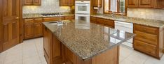Kitchen countertops have an enormous impact on the look. If you are looking for the most popular kitchen countertop materials, choose granite kitchen countertops. Cheap Granite Countertops, Kitchen Cabinets And Countertops, Kitchen Countertop Materials, Granite Kitchen, Kitchen Cupboards, Kitchen Flooring, Kitchen Backsplash, Kitchen Island, Kitchen Nook