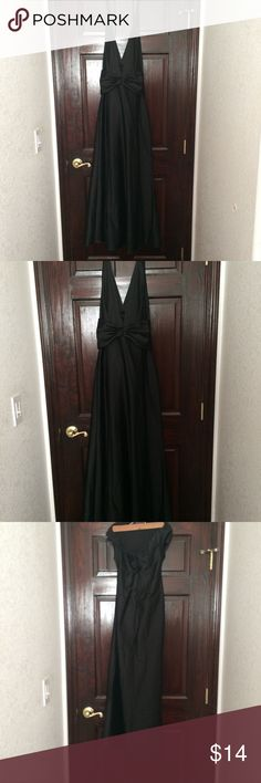 Long Black Halter Prom Dress Long Black Halter Prom Dress Size XS. Has a bow in front. Dresses