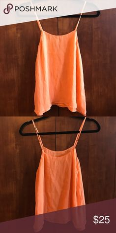 Alice and Olivia silk top!! Lovely orange silk tank!! In great condition! A beautiful quality! Alice + Olivia Tops Tank Tops