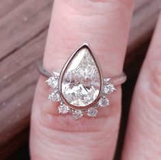 11x8, 1.85ct Pear Cut SI/H Diamond Bezel set in a 14k White Gold Diamond Fantail Setting