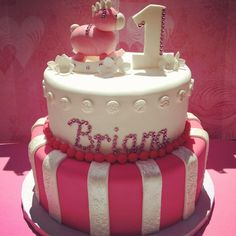 One year old birthday cake for a beautiful little girl. It was a pure joy to deliver this cake today. Her face was so precious and so happy. It is times like these when I realize how much I love my job :) both tiers were fluffy vanilla cake with vanilla buttercream frosting.