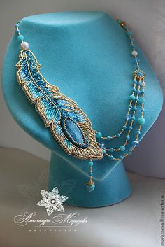 Beaded peacock feather necklace.