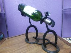 Horseshoe Cowboys Wine Rack by StylinTemptations on Etsy, $44.95