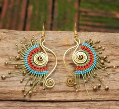 Shaped brass tribal earrings with woven cotton in blue orange and red