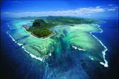 An underwater waterfall. Take a look... then take a look again If you fly into Mauritius from the right angle, this is what you'll see: a waterfall pouring into the deep.   What is it, really? It's sand from the interior of the lagoon, flowing out towards the ocean. The altitude offers a new perspective – one that the mind needs a second to process.