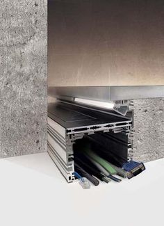 Ai Tuoi Piedi modular system for indoor use made of oxidised black extruded aluminium, conceived for the distribution of cables and other electric components under the floor. available in two versions: aituoipiedicentraleand aituoipiedilaterale.
