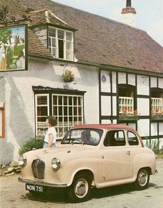 A Public House and Inn, looks to be late 50's to mid 60's. I believe the car is a Morris, but I don't know what year. My father's first car.