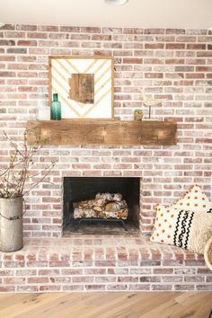 Lindsay: I'd like to whitewash the fireplace so the bricks look like this and sand back the shelf on the mantle and varnish it. Thoughts?!