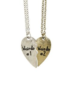 "Necklace set with burnished silver & gold tone heart halves that read ""Weirdo #1"" and Weirdo #2."""