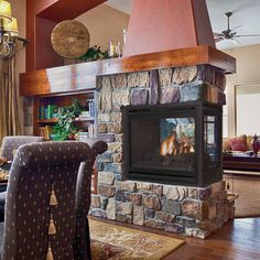 A three-sided fireplace is a great end-point to a wall or room divider! See a wide selection of peninsula, see-through, and corner fireplaces at CJ's Hearth & Home