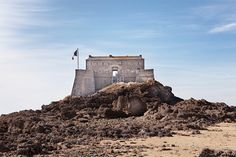 17th century fort built on Petit Be, a tidal island in France, with ancient fortress interiors and views of the beaches of Saint-Malo.