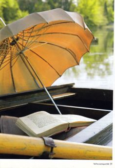 Reading and relaxing under a parasol.