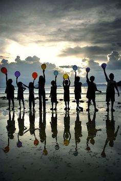 .LOVE the children's silhouettes with the bit of color from the balloons...♥