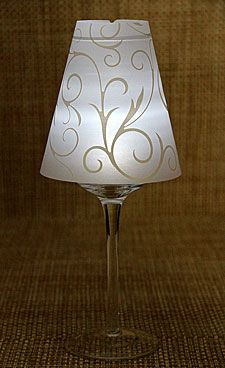 Centerpiece idea... Wine glass, lampshade for wine glass, and an LED tea light.