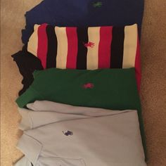 Four women's polo collard shirts Worn a few times. All are size small. The light blue is long sleeve. Let me know if you'd like more photos or purchase one separately Polo by Ralph Lauren Tops Button Down Shirts