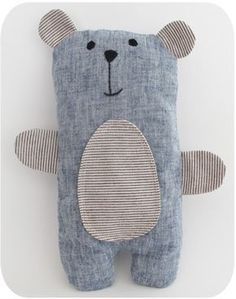 Today this stuffed bear is available to a good home. Re-homed! His body is made from a lovely blue linen fabric, and his ears and belly are a yarn dyed cotton from Lecien. If you'd like to make your own...
